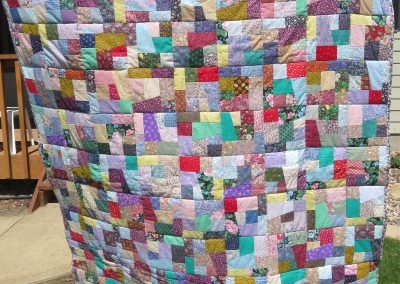 Bits & Pieces – 68x55 – Pieced & Machine Quilted – Multi colors – Made by East Side Quilters – Sioux Falls, SD