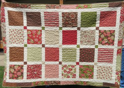 Multi Colored Blocks – 53 ½ x 75 – Pieced & Machine Quilted – Green, Rose, Browns & Neutral sashing – Made by Diane, Holly, Linda & Pat- Sioux Falls, SD