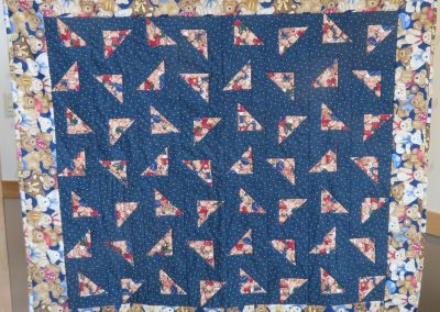 Bear on Parade – 42x46 – Pieced & Machine Quilted – Navy & Browns –Made by Diane, Holly, Linda & Pat – Sioux Falls, SD