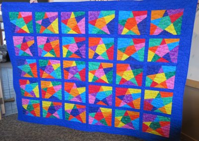 Pointess Stars – 60x82 – Pieced & Machine Quilted – Brights, Primary- Made by Diane, Linda, Holly & Pat – Sioux Falls, SD