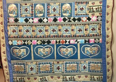 Raggedy Ann & Andy – 92x70 – Machine Quilted - Blue, Pink and Tan – Made by Berdena Buys – Slayton, MN