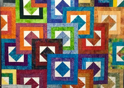 Stacked Squares – 64x72 – Pieced & Machine Quilted – Multi colors (All cotton front, back & batting wash cold water, Lay Flat to dry) – Made by Lynn Larson – Billings, MT