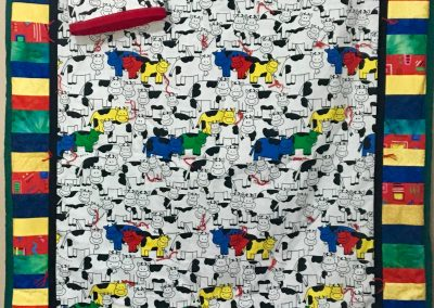 Happy Cow – 60x44 – Pieced & Tied – Primary colors – Made by Messiah Lutheran – Flandreau, SD