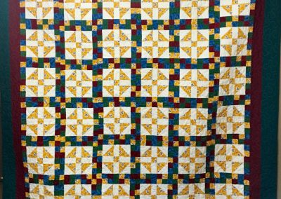 Squares on Square – 72x72 – Pieced and Machine Quilted – White, Teal, yellow, Maroon with matching pillow – Made by Bethany Lutheran quilters – Storden, MN