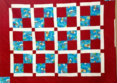 I Love a Parade – 50x61 – Machine quilted – Red, White & Blue – Made by Bethany Lutheran Quilters – Storden, MN
