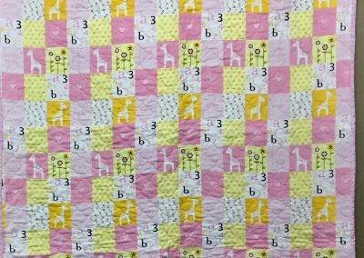 Little Cutie – 54x42 – Machine Quilted – Pink & yellow Flannel – Made by Bethany Lutheran Quilters – Storden, MN