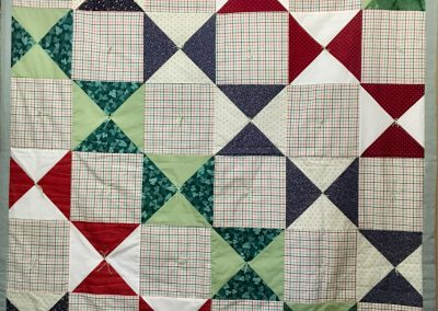 Triangles & Squares – 61x81 – Pieced & Tied – Reds, Blues & Greens – Made by Trinity Lutheran Quilters – Walnut Grove, MN